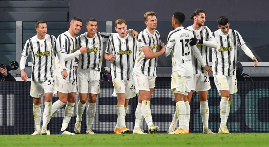 TURIN, ITALY - NOVEMBER 21: Cristiano Ronaldo of Juventus celebrates with teammates after scoring his team's second goal during the Serie A match between Juventus and Cagliari Calcio at Allianz Stadium on November 21, 2020 in Turin, Italy. Football Stadiums around Europe remain empty due to the Coronavirus Pandemic as Government social distancing laws prohibit fans inside venues resulting in fixtures being played behind closed doors. (Photo by Valerio Pennicino/Getty Images)