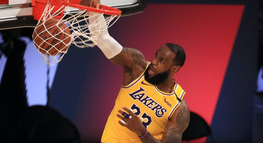 LAKE BUENA VISTA, FLORIDA - JULY 30: LeBron James #23 of the Los Angeles Lakers dunks the ball against the LA Clippers during the second quarter of the game at The Arena at ESPN Wide World Of Sports Complex on July 30, 2020 in Lake Buena Vista, Florida. NOTE TO USER: User expressly acknowledges and agrees that, by downloading and or using this photograph, User is consenting to the terms and conditions of the Getty Images License Agreement. (Photo by Mike Ehrmann/Getty Images)
