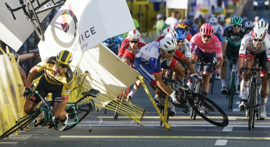 Dutch cyclist Dylan Groenewegen crashes to the ground as a bicycle is flying overhead in a major collision on the final stretch of the opening stage of the Tour de Pologne race in Katowice, Poland, on Wednesday, 05 August 2020.  The crash began with Groenewegen colliding with another Dutchman sprinting for the win, Fabio Jakobsen, who was hospitalized in serious condition and put into induced coma. Jakobsen was declared the winner and Groenewegen was disqualified.(AP Photo/Tomasz Markowski)