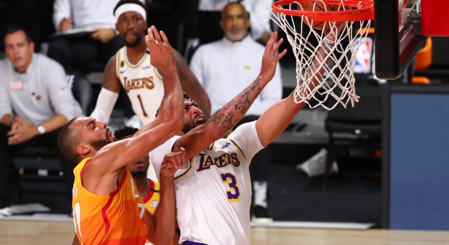 LAKE BUENA VISTA, FLORIDA - AUGUST 03: Anthony Davis #3 of the Los Angeles Lakers is fouled on a drive to the basket by Rudy Gobert #27 of the Utah Jazz during the first half of an NBA game at The Arena at ESPN Wide World Of Sports Complex on August 3, 2020 in Lake Buena Vista, Florida. NOTE TO USER: User expressly acknowledges and agrees that, by downloading and or using this photograph, User is consenting to the terms and conditions of the Getty Images License Agreement.  (Photo by Kim Klement - Pool/Getty Images)