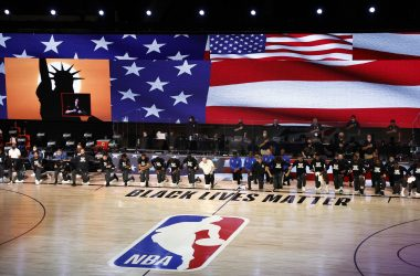 epa08623202 Members of the Orlando Magic and the Milwaukee Bucks take a knee during the national anthem before their NBA basketball first-round playoff game four at the ESPN Wide World of Sports Complex in Kissimmee, Florida, USA, 24 August 2020.  EPA/JOHN G. MABANGLO SHUTTERSTOCK OUT